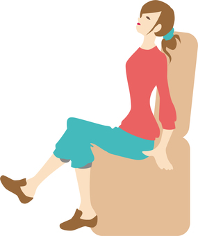 A woman sitting on a sofa and relaxing