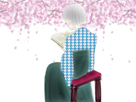 讀書和櫻花的小女孩