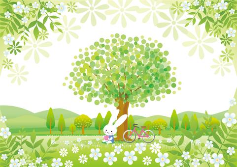木陰で読書するうさぎと草花