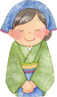 お辞儀をする和装のウエイトレス 三角巾付