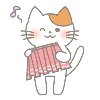 Cat choosing a skirt