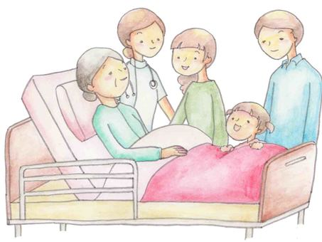 Family surrounding grandmother of bed and doctor