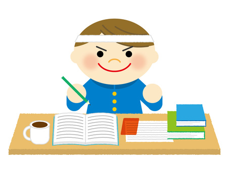 A boy studying for an exam