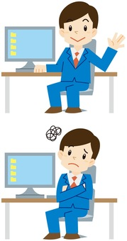 パソコンの前にいる男性