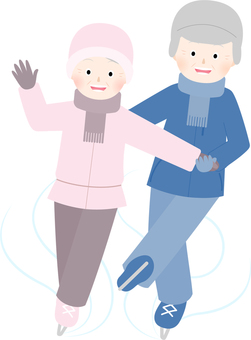 An elder couple dueting at skating