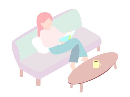Woman reading while relaxing on the couch