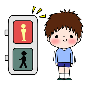 Boy waiting for traffic safety red light