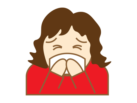 A woman holding her mouth and sneezing