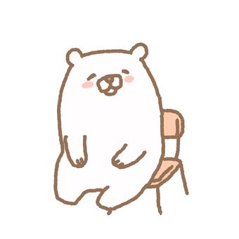 A white bear sitting on a chair