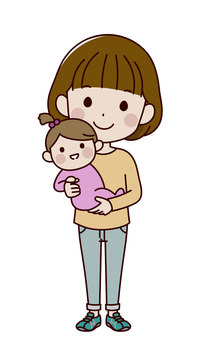A woman holding a girl