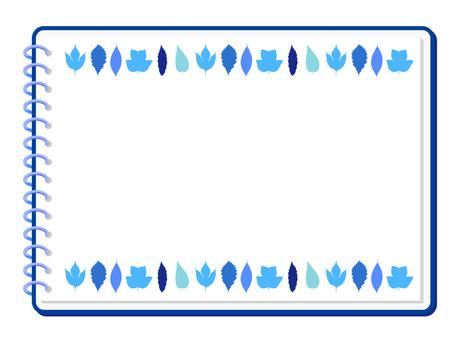 Blue tree leaves and sketchbook