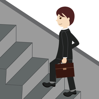 A businessman going up the stairs