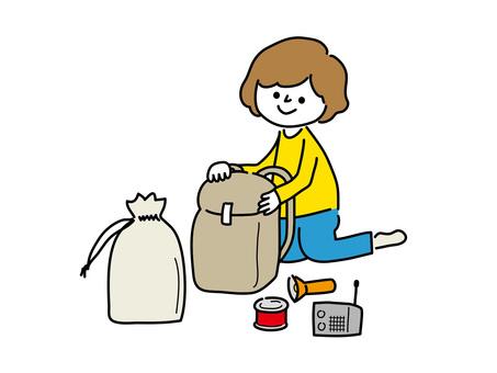Woman preparing emergency bag