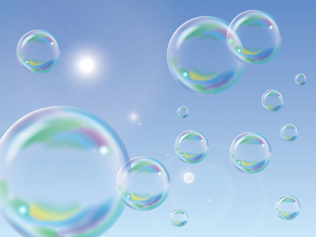 Soap bubbles floating in the blue sky