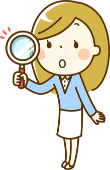 A woman with a magnifying glass