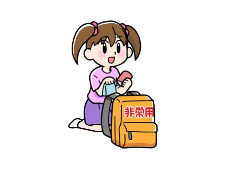 Girl checking disaster prevention bag