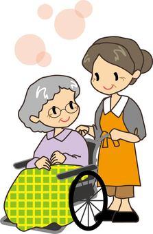 Senior woman pushing wheelchair