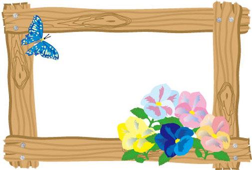 Frame of woodgrain-like wooden frame and pansy flower