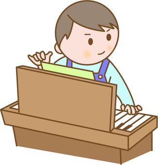 Male nursery teacher playing the piano