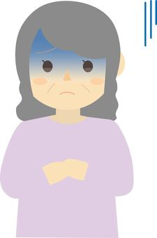 An old woman who seems to be painful
