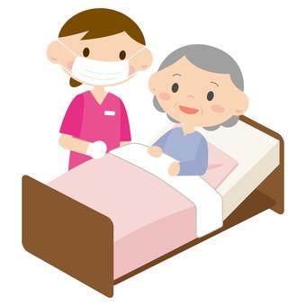 Women receiving treatment in bed 2