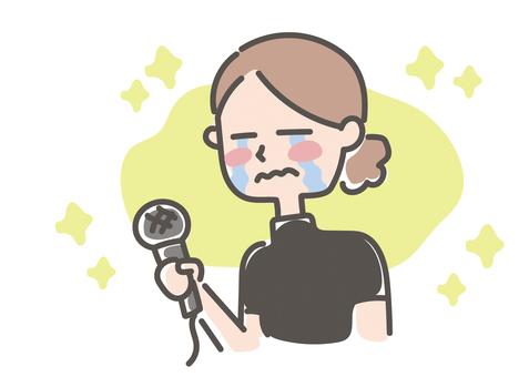 インタビューするコーチ・先生(女性)