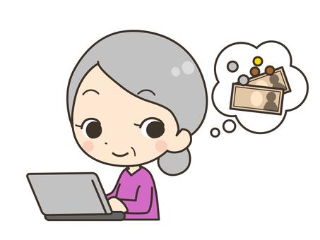 使用計算機的年長婦女