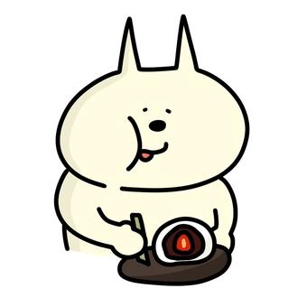 Cat eating strawberry daifuku