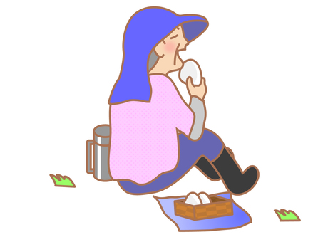 A woman eating a rice ball