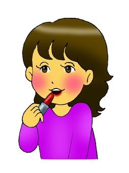 A woman applying lipstick