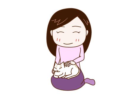 猫がお膝にきて可愛がる女性