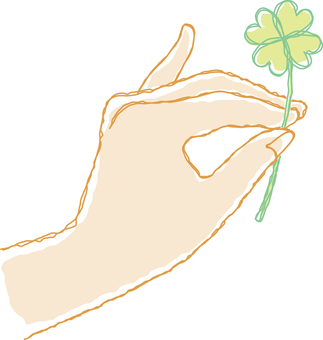 Hand holding the four leaf clover