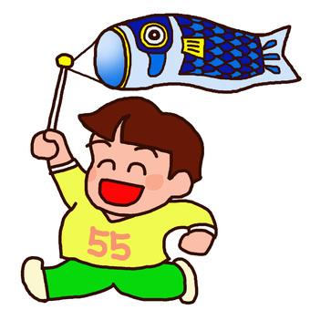 A boy who rejoices with a carp streamer