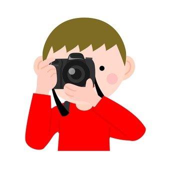 Boys holding a camera