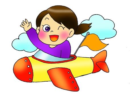A girl riding an airplane