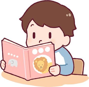 Boy reading an animal book