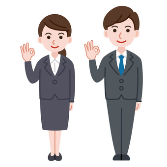 Men and women in suits ok pose