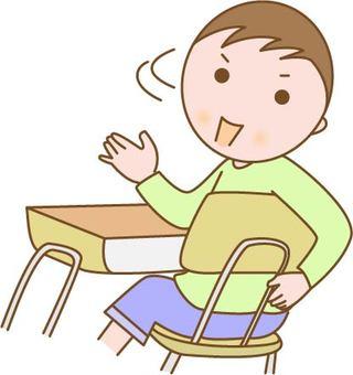 A boy sitting in a chair