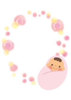 赤ちゃんとピンクの水彩模様の枠