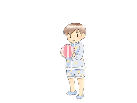 Boy holding a beach ball