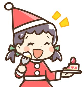一個吃聖誕蛋糕的女孩