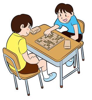 将棋を指す子供