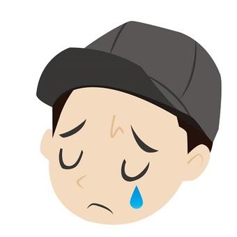 A man with a sad cap