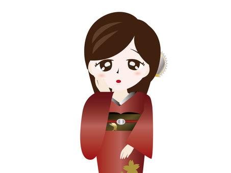 뺨에 손을 대는 기모노 여성