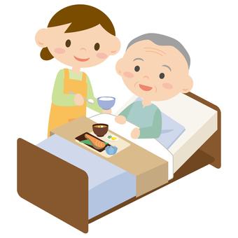 침대에서 식사를하는 남성과 시중 여성