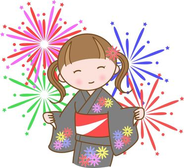 Girl in yukata with fireworks