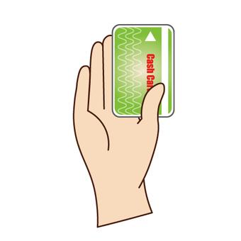 キャッシュカードを手に持つ手