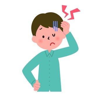 医療-頭が痛む男性