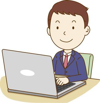 A businessman operating a laptop computer
