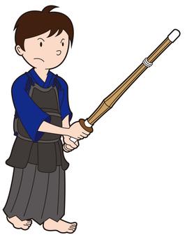 A kendo boys holding a bamboo sword 2